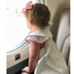 This new member of the #prettyinpink #Flexjetbabies club took a moment to admire the view before buckling up in a Flexjet #Gulfstream #G450  Your #preciouscargo is our precious cargo.   @taylorgconway @laurengconway