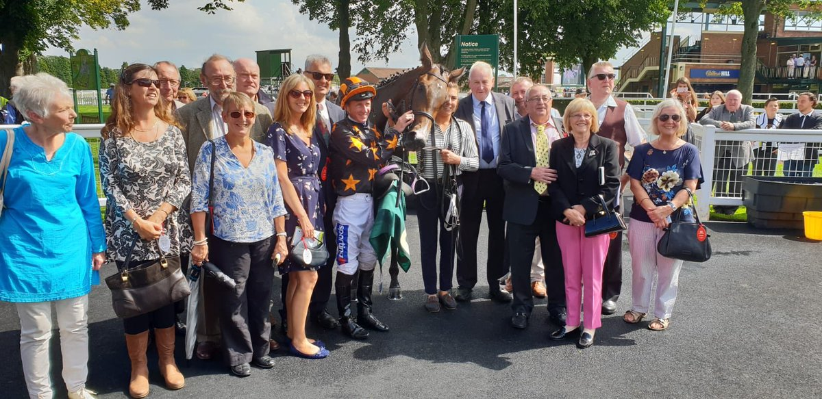 Mrs Hoo in the Ripon winners enclosure with lots of members of the Richard Fahey Ebor Racing Club