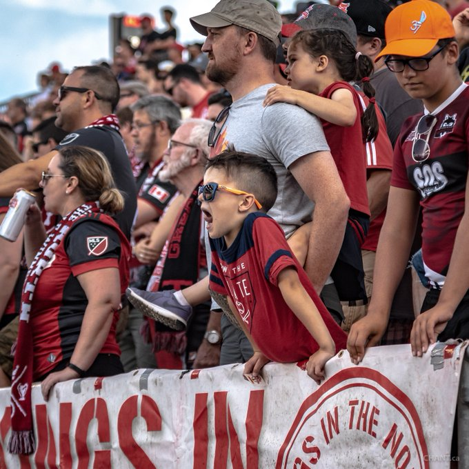 The future supporters of @torontofc . Also, we tip our cap to the dad in this picture for getting a good workout in at the match by carrying the little one #tfclive (photo credit: .@chant_photo ) Photo