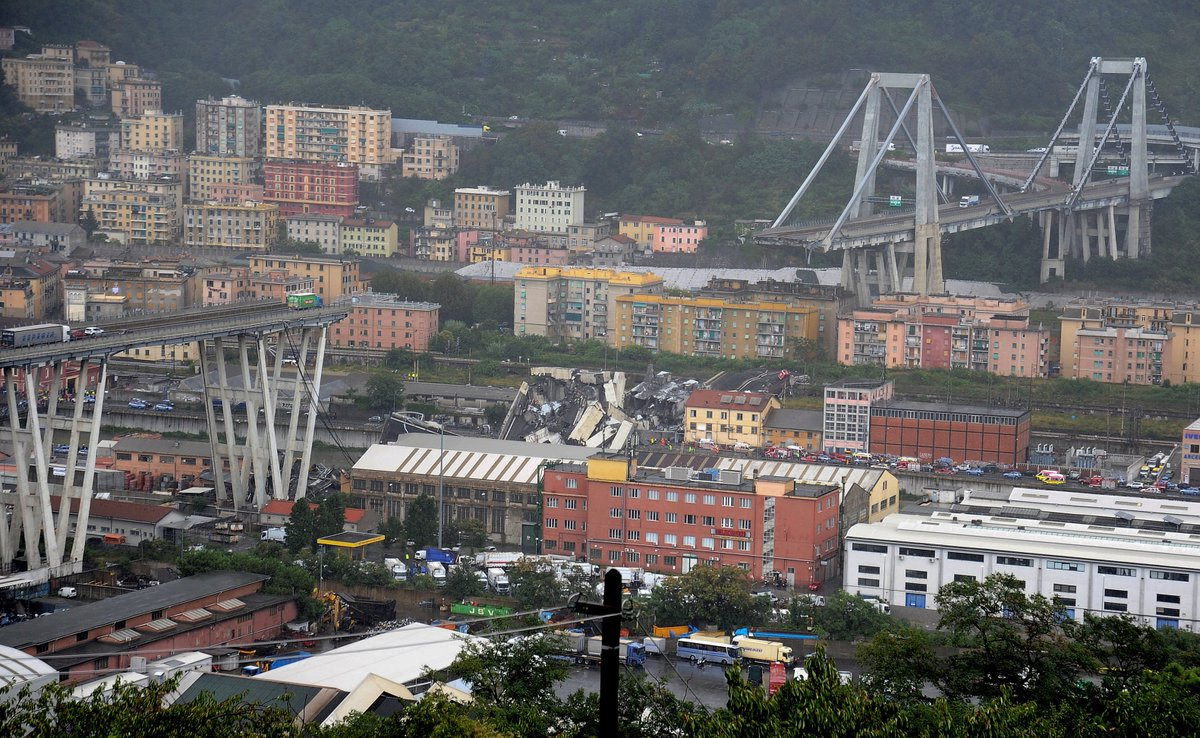 A motorway bridge has collapsed in Genoa, Italy, killing at least 20 people. Part of the bridge came down during a sudden storm, according to local media.