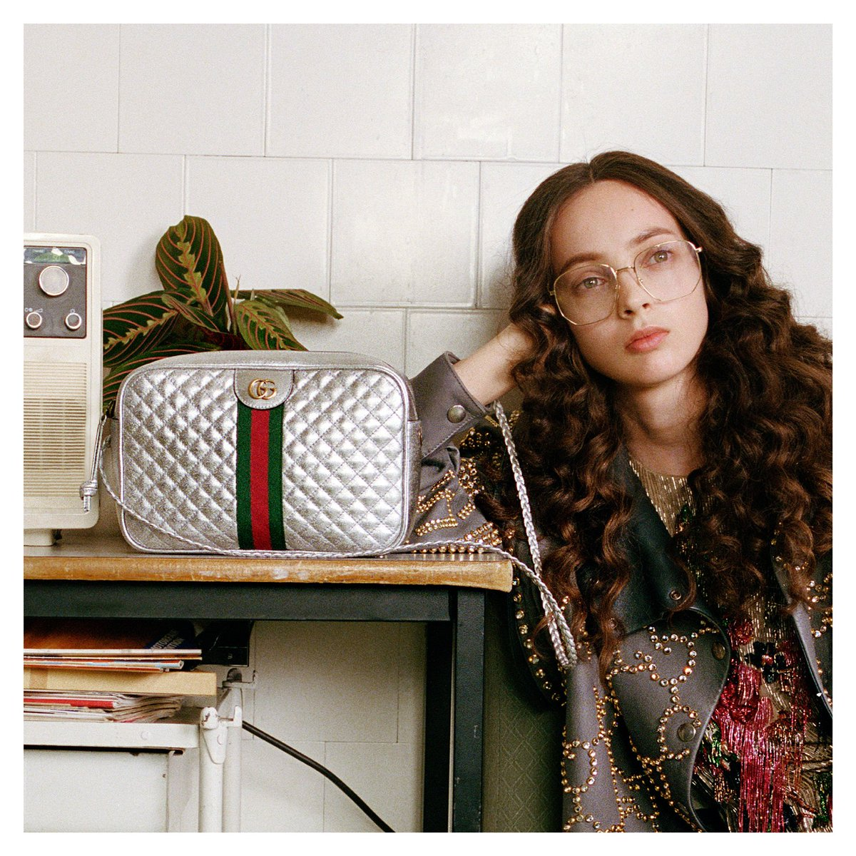 From #GucciFW18 by #AlessandroMichele, a matelassé shoulder bag in laminated silver leather featuring the Double G and the House Web stripe.