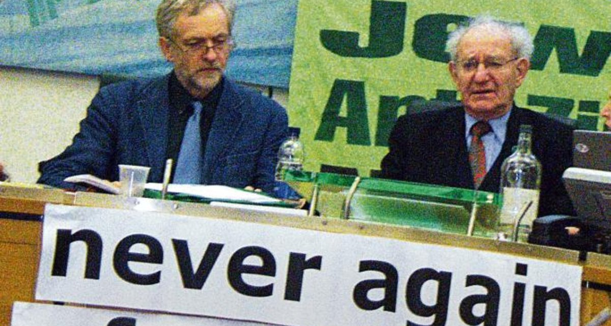 My Jeremy chaired this &quot;Never Again&quot; event on a Holocaust Memorial Day, when Israelis were compared to Nazis, but you can tell by the distant look in his eyes that he is physically present, but mentally is elsewhere. Possibly at a Hamas training camp in Gaza. <br>http://pic.twitter.com/ugcnqMWmnO