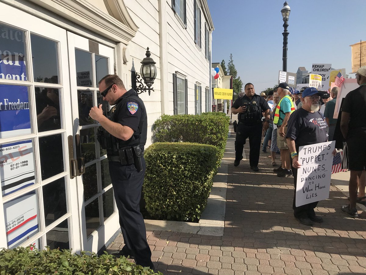 Myself and others tried to see if anyone was available in @DevinNunes office, where a rally is being held outside. Front office staff called the police and kicked me out. <br>http://pic.twitter.com/dzJR3c5Mnn