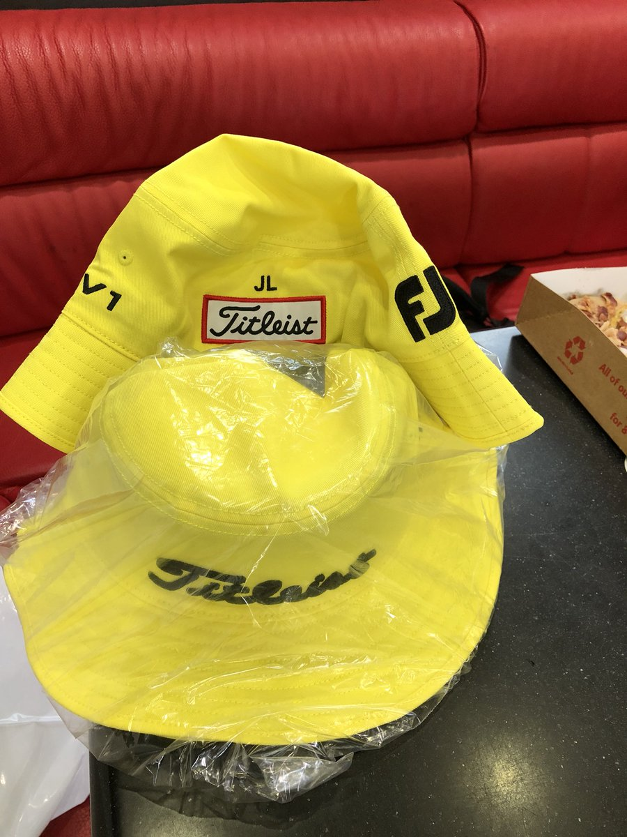 "Titleist sent a bunch of yellow bucket hats with the initials ""JL"" in  memory of Jarrod Lyle for players and caddies to wear at this week s ... 195c885d105"