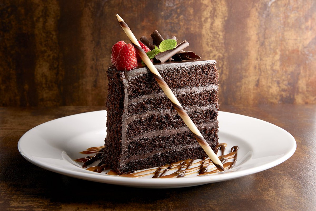 An indulgent and decadently rich flourless chocolate torte, flavored with Tuaca and espresso, and topped with luxurious dark chocolate ganache. #fleminco #creatingMemories <br>http://pic.twitter.com/XD2DH3Brqc