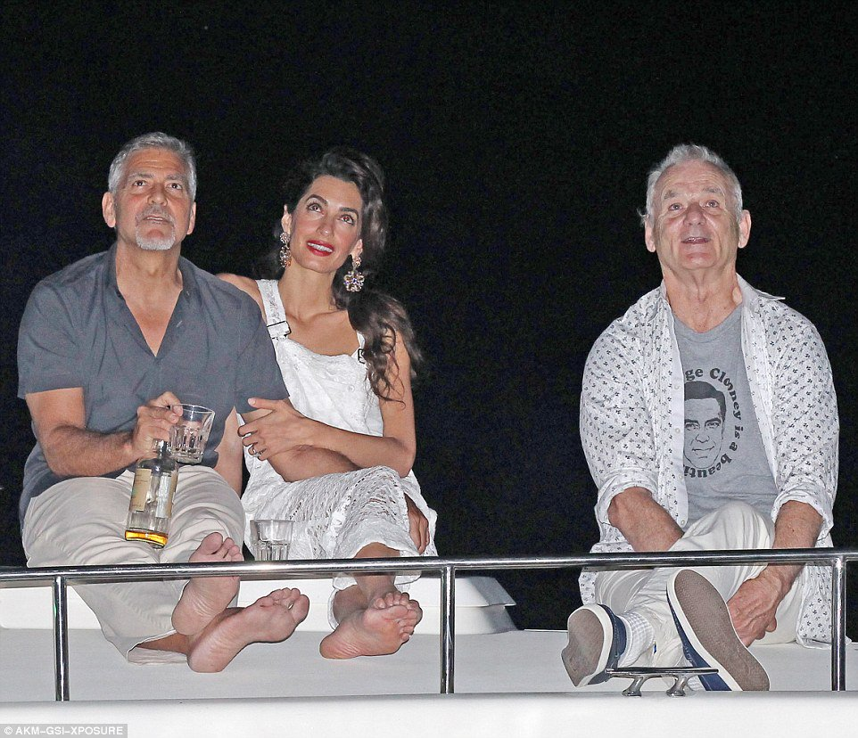 Bill Murray wearing a &#39;George Clooney Is A Beautiful Man&#39; shirt while watching fireworks with George Clooney. <br>http://pic.twitter.com/kfXYgvQHiG