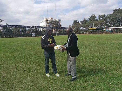 test Twitter Media - Fantastic to receive this image of the Chairman of Rugby Patrons Support Group, Aggrey Chabeda, donating two Samurai match balls to Ernest Ngong, Head Coach of Nationwide League club COMRAS Rugby at RFUEA grounds, Ngong Road today! #SamuraiFamily https://t.co/KwqtlyBY8Q