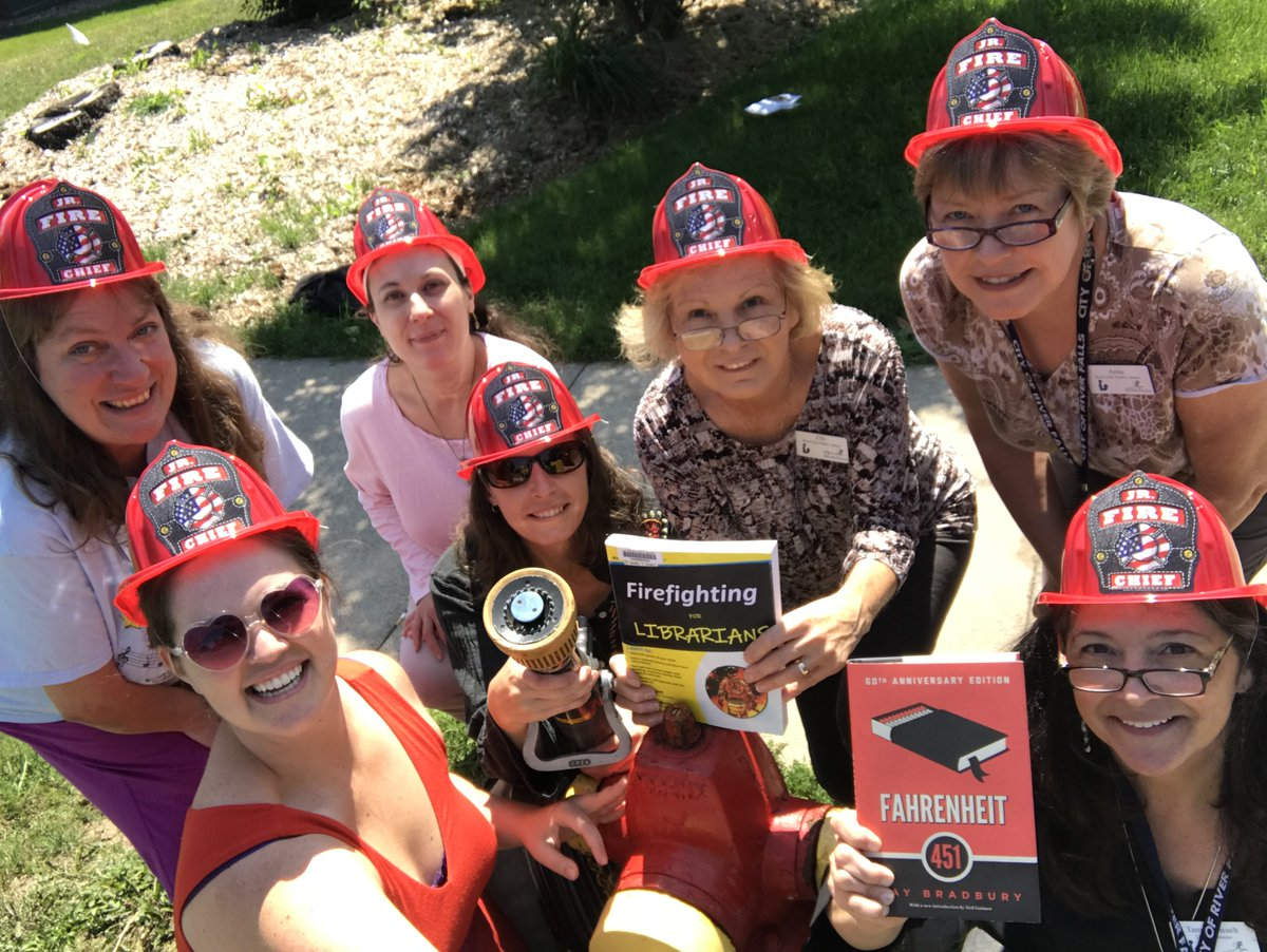 4/River Falls library staff consult the bestselling &quot;Firefighting for Librarians&quot; when they attempt to attach a fire house to a hydrant. #CityHallSelfie Switch-Up Day in River Falls continues ... @WisconsinLibs @ALALibrary @ALA_PLA @SCFWPL @ELGLSconnie<br>http://pic.twitter.com/NCbtgJDMSe