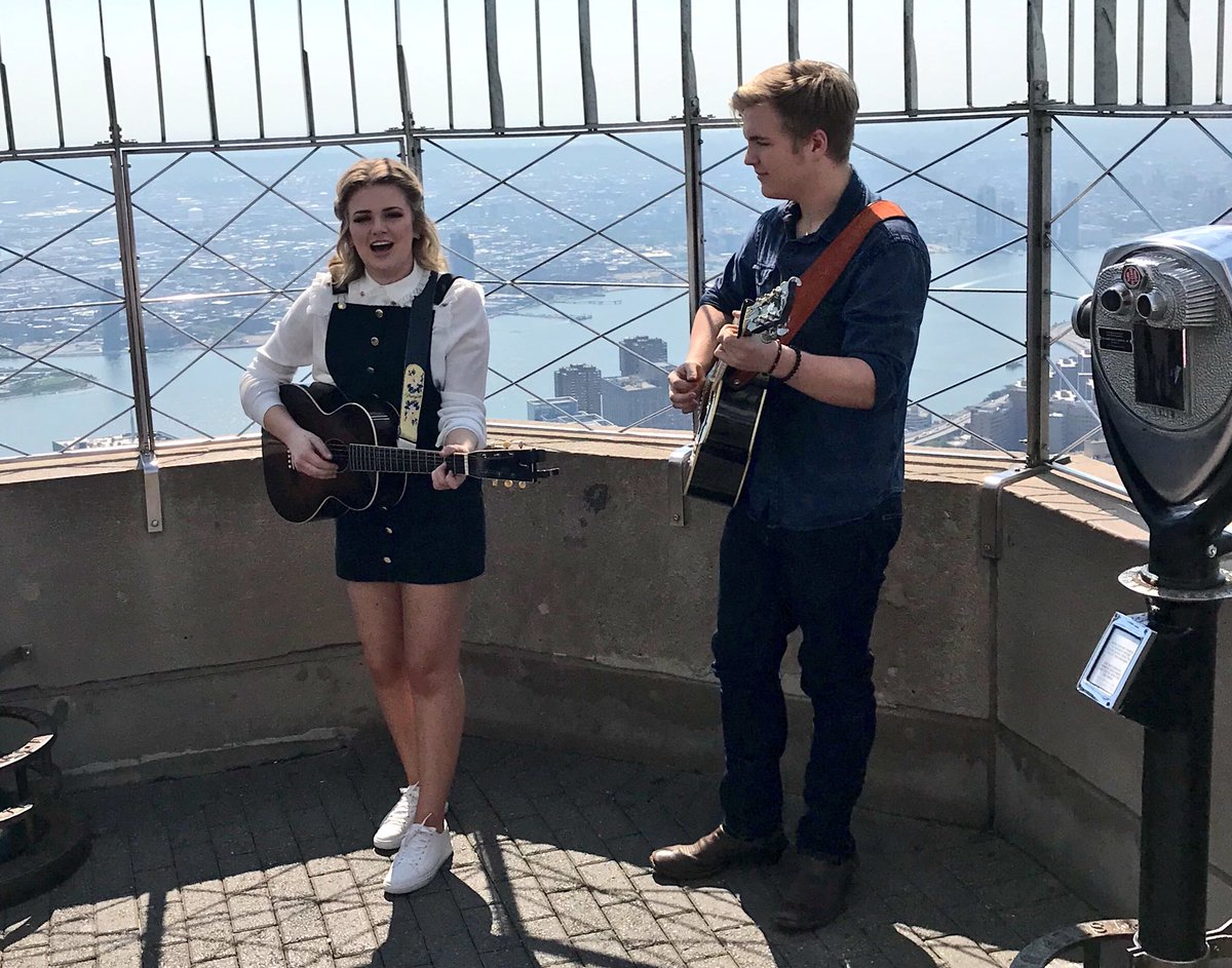 Today @AmericanIdol's @MaddiePoppe and @calebleemusic performed on top of the @EmpireStateBldg in NYC!