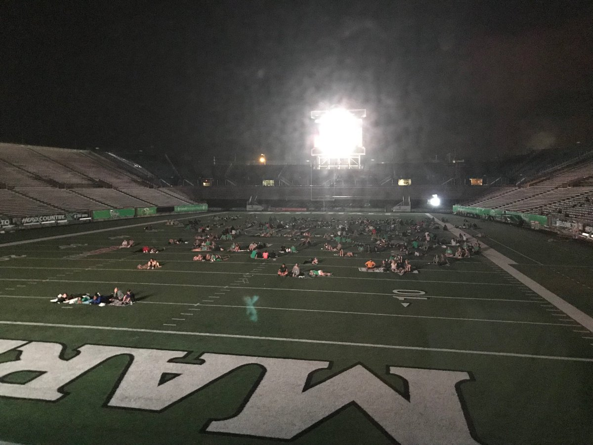 Looking out my office window tonight after @HerdFB practice and seeing 80 yards worth of our @marshallu class of 2022 watching We Are... Marshall is good for the heart. What a special place. #HerdFamily<br>http://pic.twitter.com/EafMLbMAV3