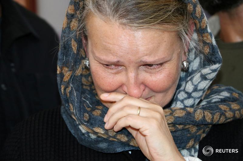 Lise Grande, UN humanitarian coordinator in Yemen, reacts as she visits children injured in last week's air strike that killed dozens at a hospital in Saada