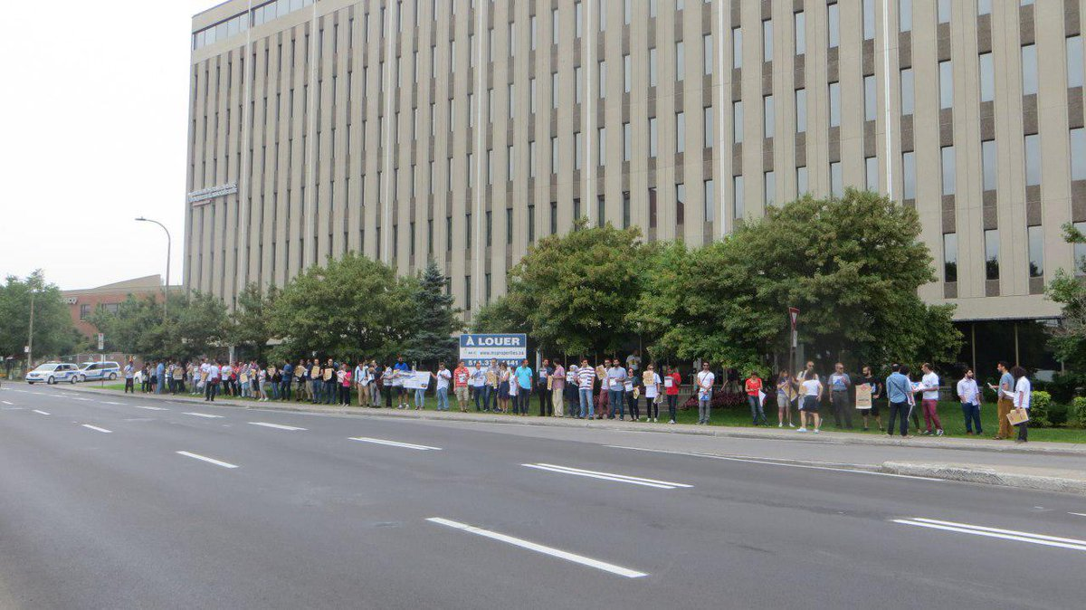 Dozens of Iranian nationals, today, in front of @JustinTrudeau office, are supporting #DelayedIranianApplications campaign and demonstrating against what they call unjust delays in the permanent residency application process, specifically for the #Quebec_Skilled_Worker stream.<br>http://pic.twitter.com/BzLBSWwESS