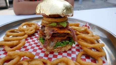 Wanna a bite of this 24-karat gold, $100 burger? CNE unveils this year's wacky treats https://t.co/QqfsgNCQqi