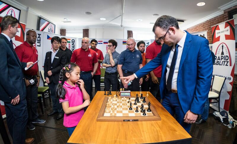 There are no games today but you can watch Ultimate Moves live on our website in 2 hours! Are you team Rex or team Randy? Can you name the youngster playing @chessleinier in this photo?<br>http://pic.twitter.com/hnPDMwemEG