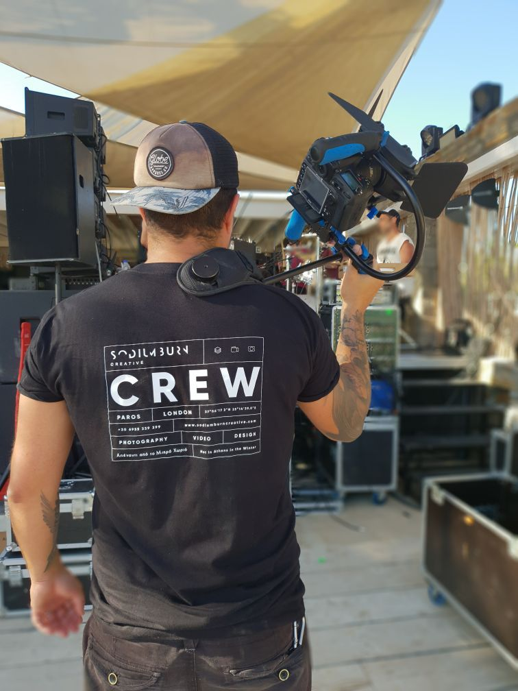 Working in #Drios on the south side of #Paros #island shooting #popgroup #Onirama, performing on the beach for @blueresidenceparos wearing our new #CREW #tshirts! #snazzy #workwear #simulacrastudio #londonphotographer #parosphotographer #mykonosphotographer
