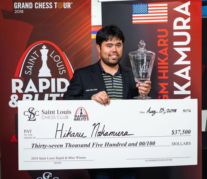 The winner of 2018 Saint Louis Rapid and Blitz @GMHikaru with his trophy and check. Congratulations again!! <br>http://pic.twitter.com/vBbTJ9yL2j