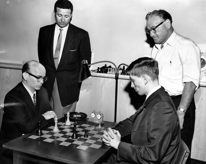 Sammy Reshevsky &amp; Bobby Fischer, during their 1961 match (New York/Los Angeles). On the board is the final position from the 5th game (played 27th July), which features in &#39;My 60 Memorable Games&#39;; the photo appears staged however. (Photo:  http://www. lapl.org / &nbsp;  .) #chess <br>http://pic.twitter.com/msHuyq44Rj