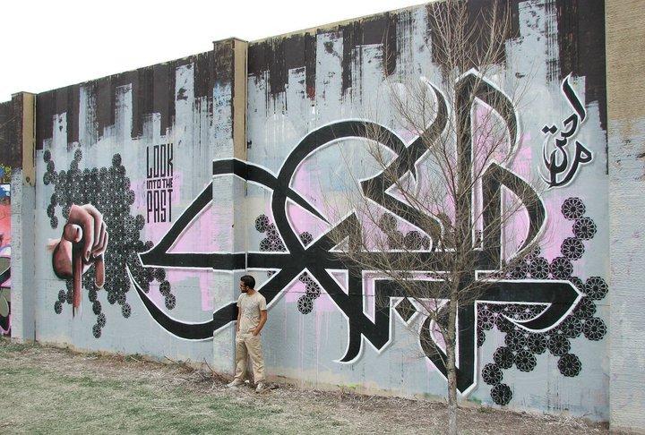&quot;Look into the Past&quot; | Mural by French artist El Seed in Tunis, Tunisia  #streetart #graffiti #стритарт #граффити #arteurbano #tunis #tunisa #urbanart #muralart #graffitiartist #streetartist #wallart #artderue #art #mural #elseed    via philosufi |  https:// goo.gl/Nqpqda  &nbsp;  <br>http://pic.twitter.com/LKODfpJUbE