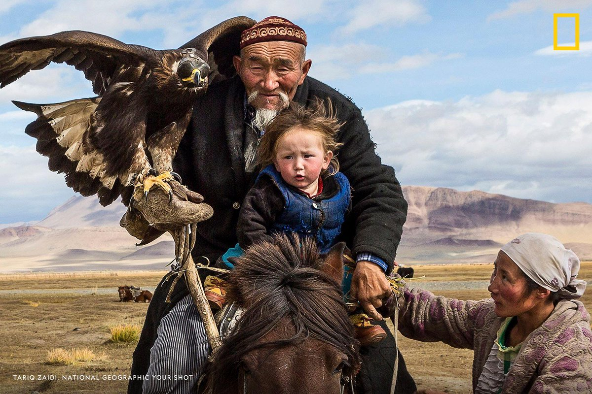 'A woman makes sure that her child; the eagle hunter's grandson is safely secure.' This moment was captured by #YourShotPhotographer Tariq Zaidi. https://t.co/SoHoIKy0Ar