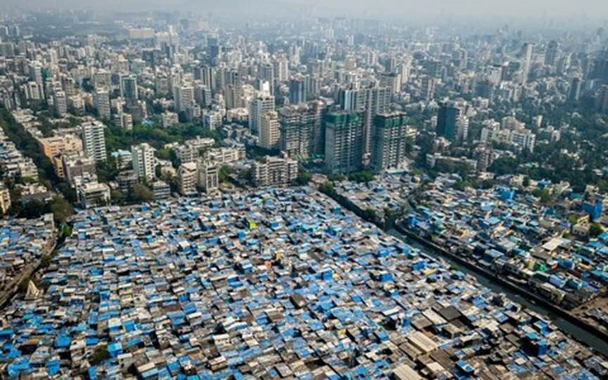 The landscape of inequality in Mumbai.   (photo: Johnny Miller)