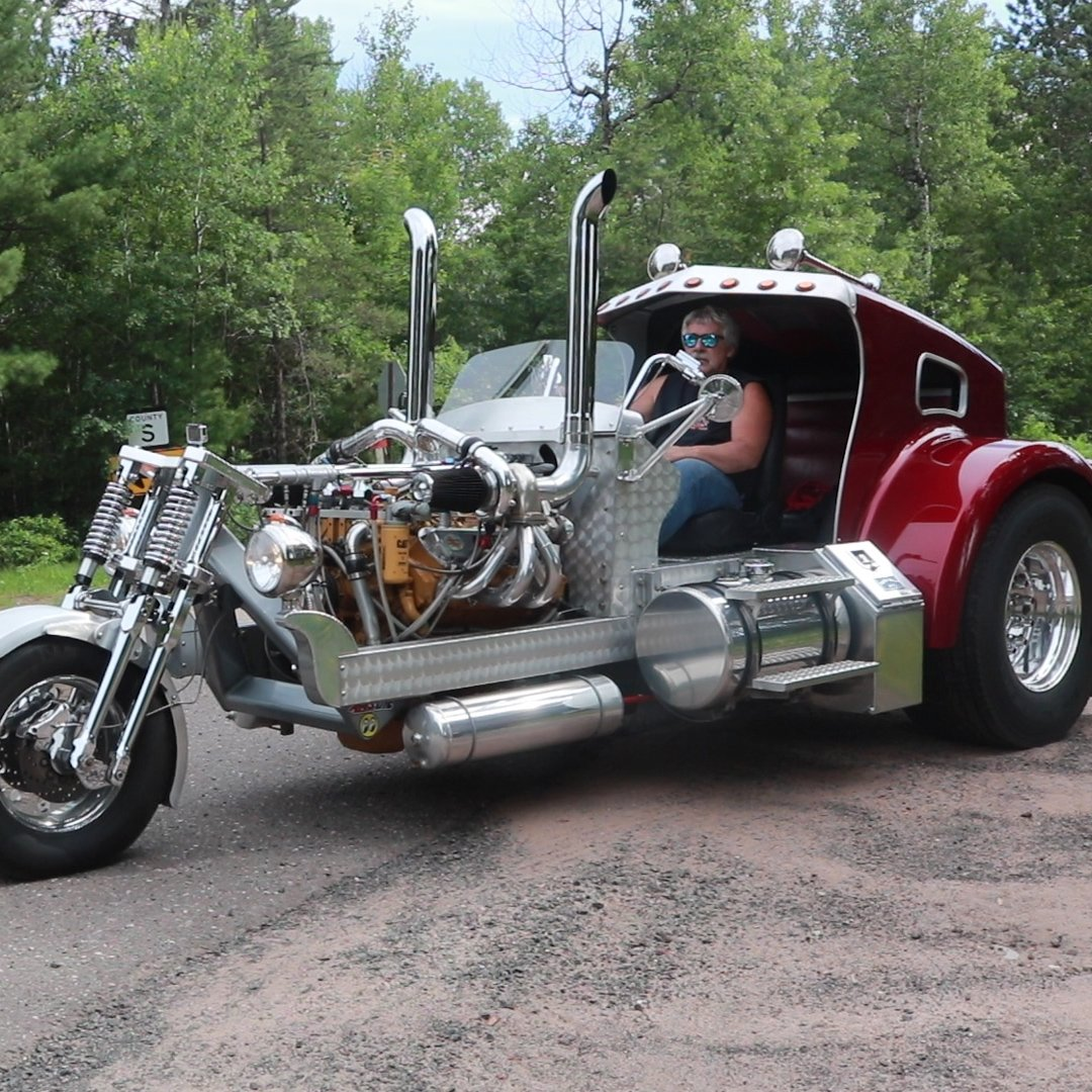 The hood of a semi is used as the trike's canopy