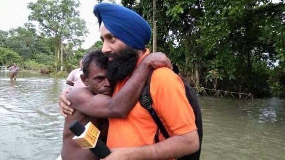 Just saw this pic on the net. Apparently a Punjab TV journalist comforting a man in Kerala who he had helped take to a safer place.. This is the India that makes me proud. This is Incredible India...