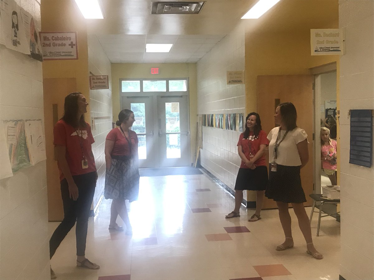Way to go OCE 2nd grade team greeting kids every morning with a smile.  A great way to model social learning! #showthemyoucare #schoolcounselor @OliveChapelElem @RuthSteidinger @WakeSchCounslor<br>http://pic.twitter.com/1N7lW0b7Ni