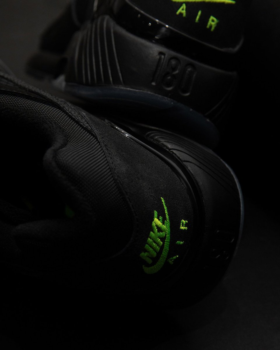 """new arrival f3e2a 1da20 Nike Air Max 180 """"Night Ops"""" is now available in-store and online. This  model features an all black nubuck and mesh upper with hits of Volt  throughout the ..."""