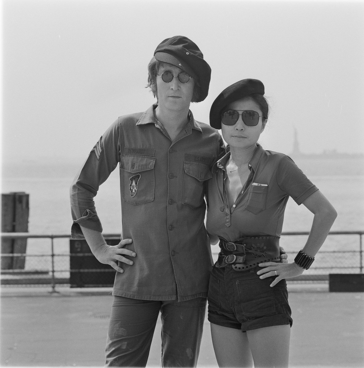 John Lennon And Yoko Ono In Battery Park NYC Statue Of Liberty Is