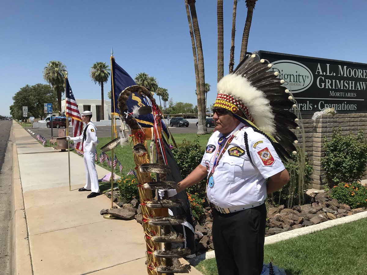 The scene outside the mortuary where John McCain's body is being protected. Volunteers from the military and the Lakota tribe are protecting him as well.