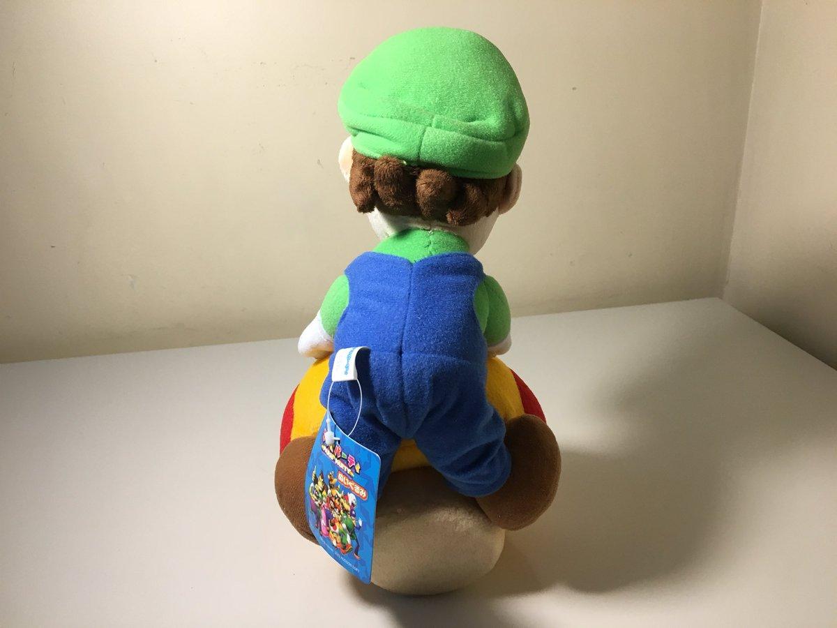 mario holding a mushroom plush