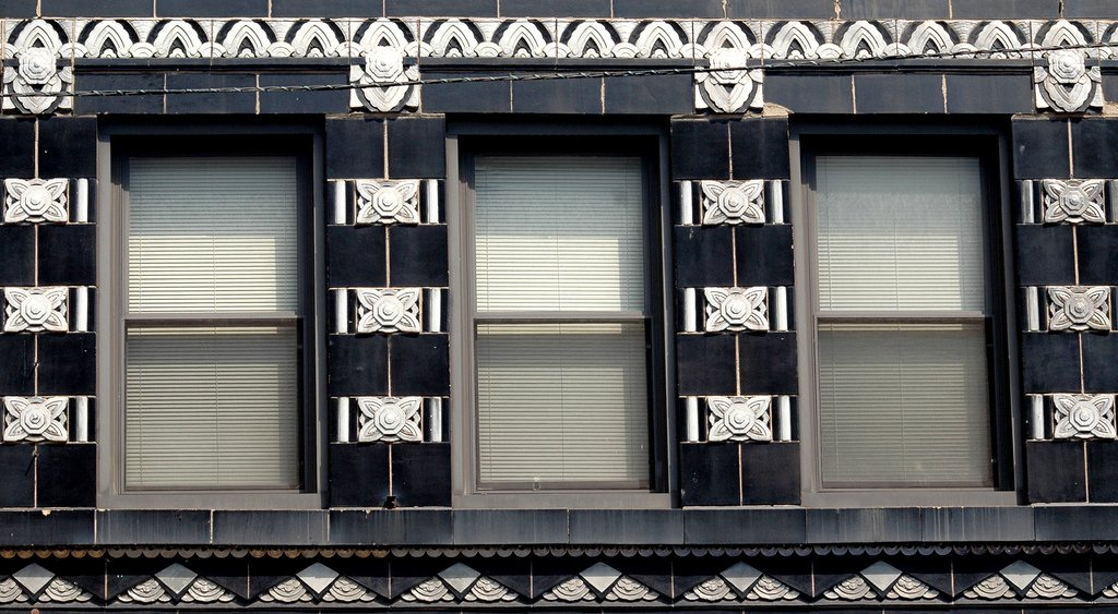 #wednesdayarchitecture Black and white glazed terra cotta ornamentation on a commercial building at the corner of Lincoln, Belmont and Ashland Avenues in Chicago, Illinois. via Terence Faircloth on twitter #detail #architecture #chicago