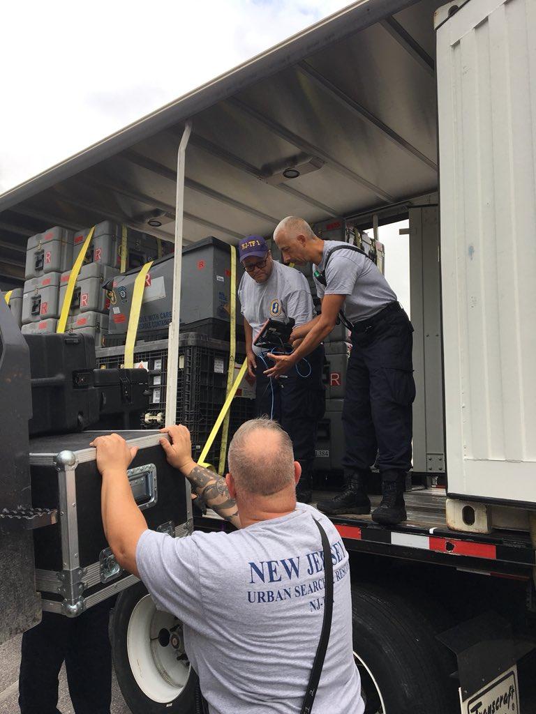 USAR team members unload truck