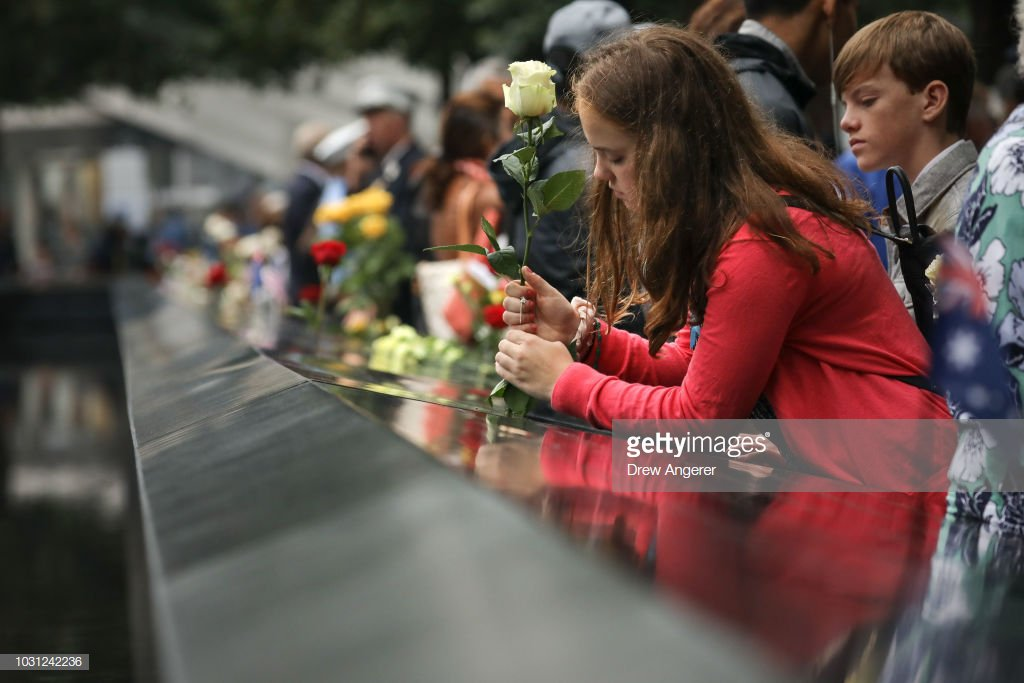 People pay their respects during a commemoration ceremony for the victims of the September 11 terrorist attacks at the National September 11 Memorial. In NYC and throughout the US, the country is marking the 17th anniversary of the September 11 terrorist attacks. 📷: @drewangerer