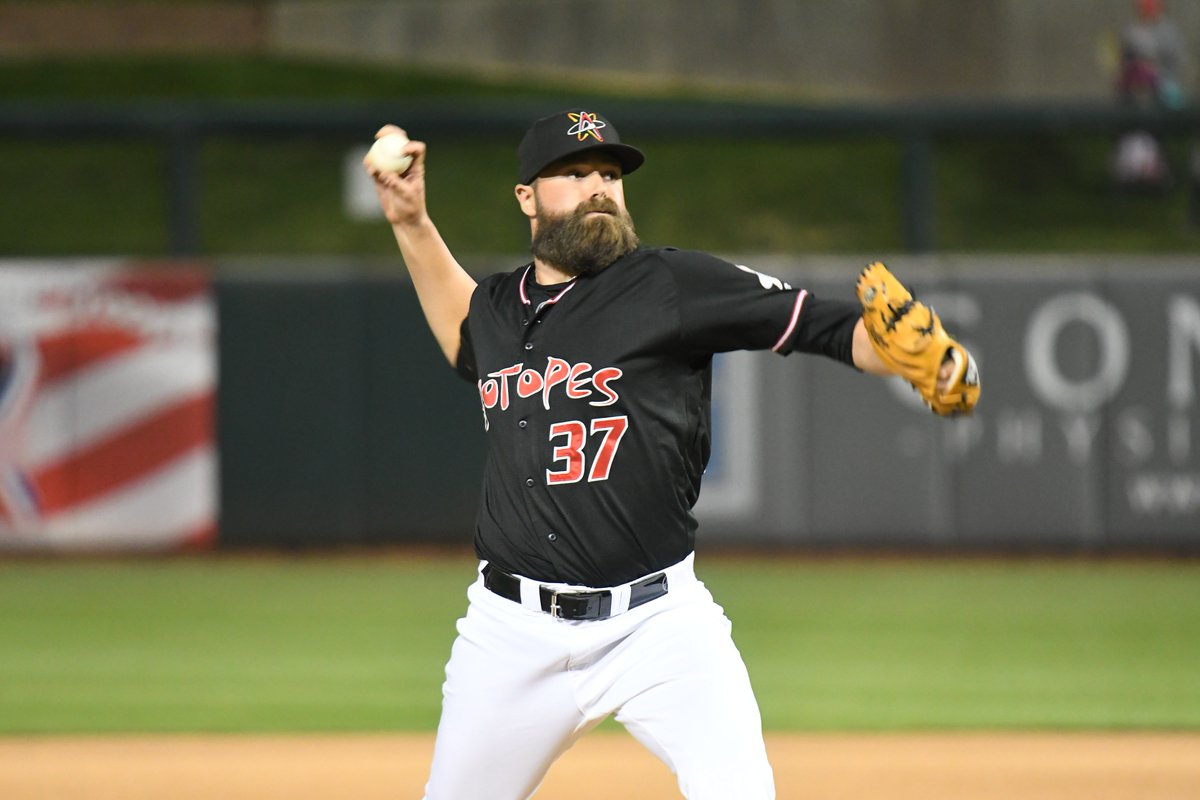 Image of DJ Johnson pitching for Albuquerque Isotopes