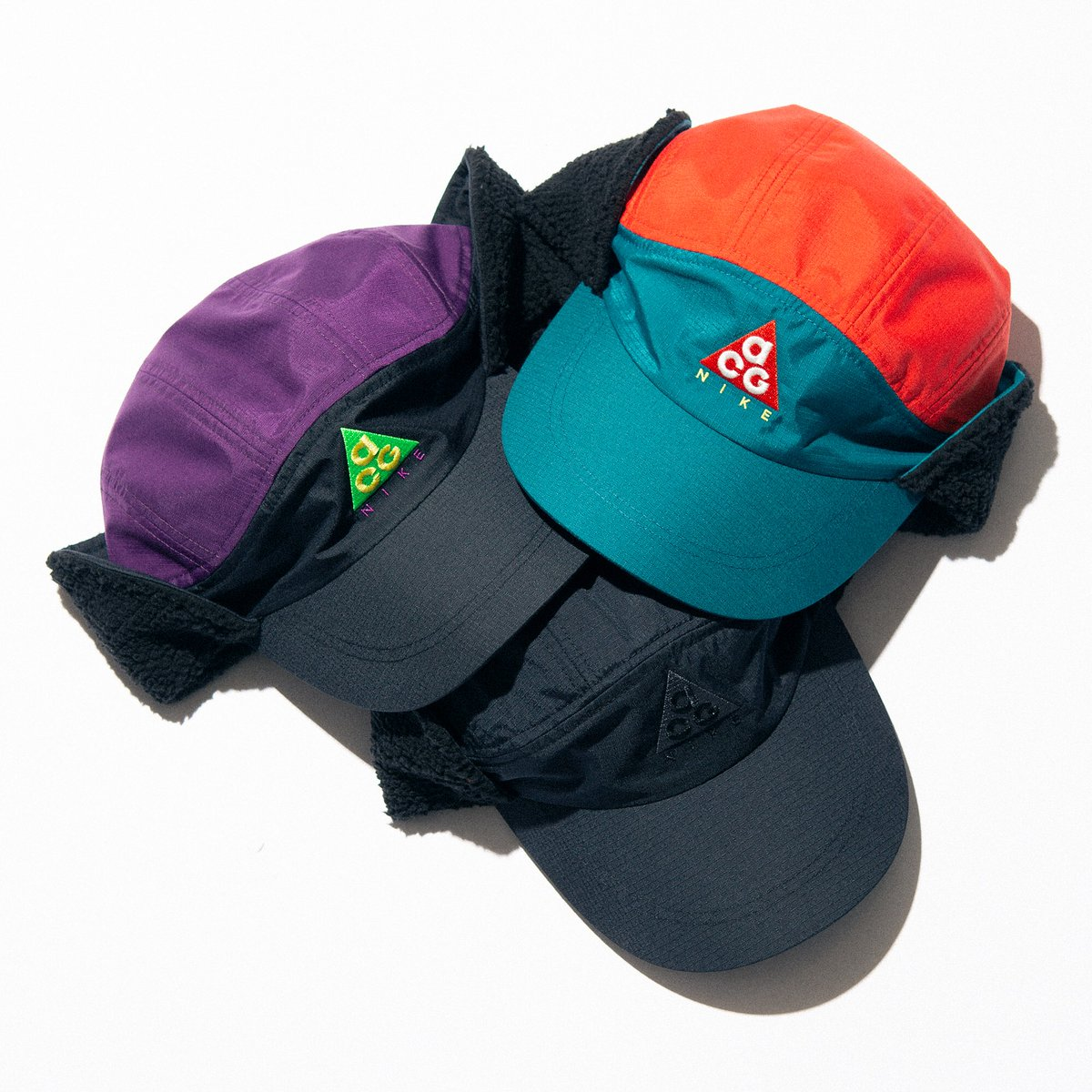99baabaf Deconstructed nylon hats with curved brims and 90's-inspired color ways.  Fleece ear flaps to be worn up or down, for all climates and temps.