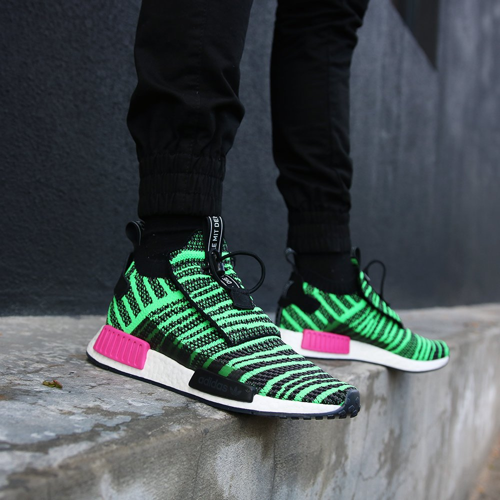brand new 2488b 435fe ... adidas NMD TS1 Primeknit - Core BlackShock Lime is now available at  both our CPT and JHB stores, as well as online. Shop now httpsbit.ly2NR0dDt  ...