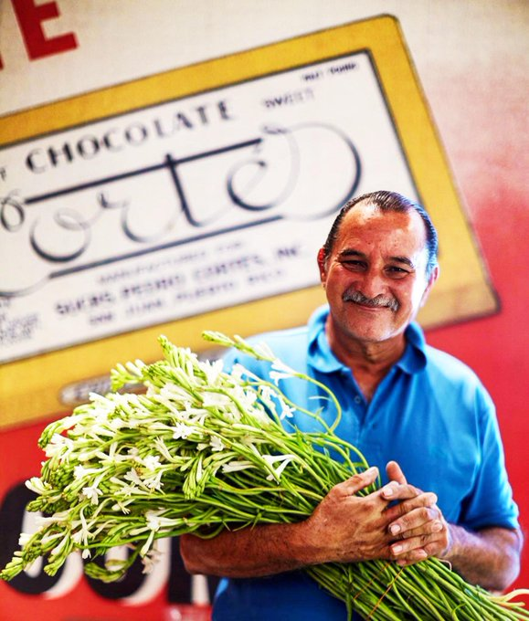 Image of smiling Don Saul with flowers