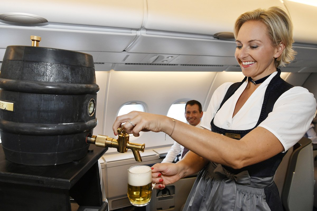 """O'zapft is"" – our Lufthansa crew is serving our guests in traditional costumes again this year on selected long-haul flights and European routes. A special delicacy: after more than 50 years, the business class will be served beer from the barrel again. #Lufthansa #Oktoberfest"
