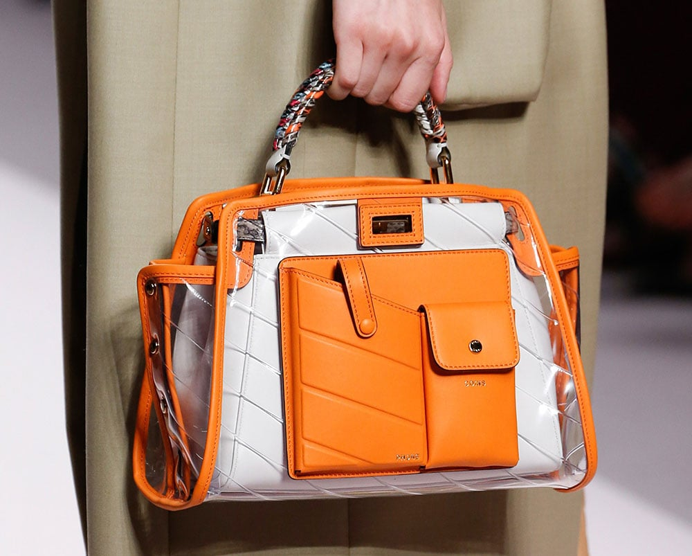 Fendi s Spring 2019 Runway Bags Emphasize Utility Pockets and Embossed  Leather Logos - https   1837357c43