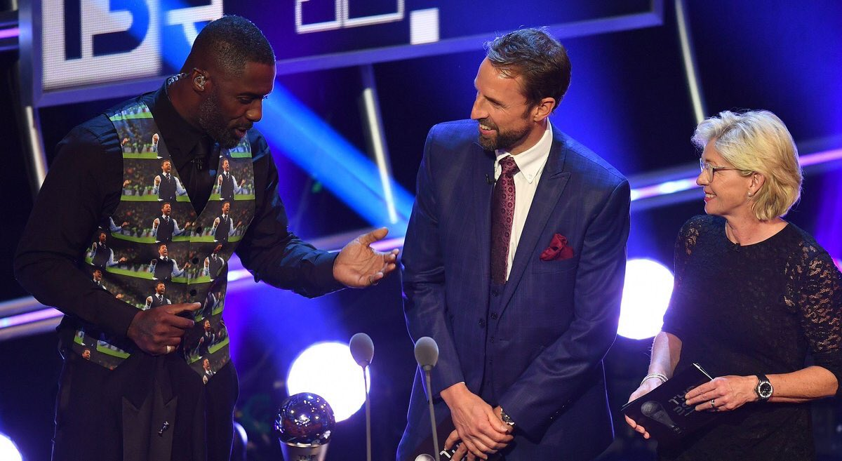 Idris Elba is wearing a waistcoat with Gareth Southgate in a waistcoat on it while standing next to Gareth Southgate wearing a waistcoat