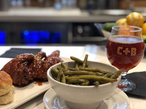 When in doubt, eat Chicken + Beer. #chickenwings #beer #collardgreens