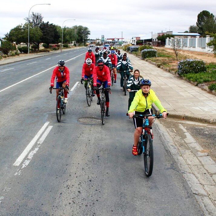 Happy @redsockfriday from the 2018 Unogwaja Team #ShoOops!   Another special moment on the Unogwaja Challenge is when the kids from Union High cycle with us to their school.   We are #BetterTogether   #WeAreUnogwaja #Unogwaja  #Investing https://t.co/bseNtbvry7