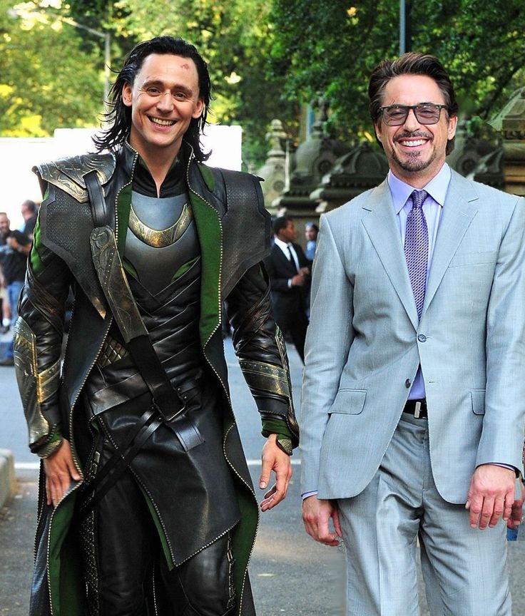 Loki walking with Tony