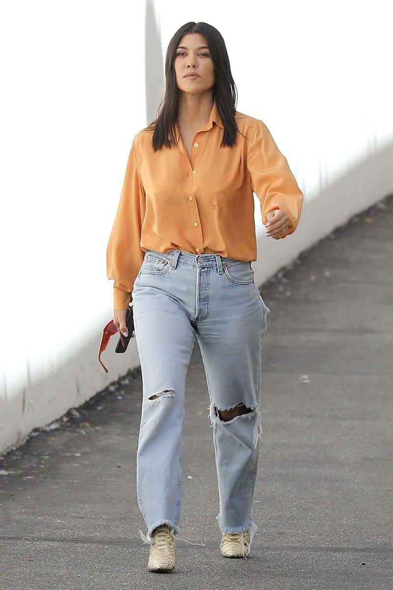 8425ca7c44c555 Kourtney Kardashian in Levi's 501 Taper Jeans - https://denimology.com/