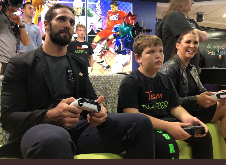 .@WWERollins & @StephMcMahon gaming @ChildrensTheOne Dallas with a fighter! #PediatricCancerAwareness #ConnorsCure https://t.co/p2EoWuX6YH