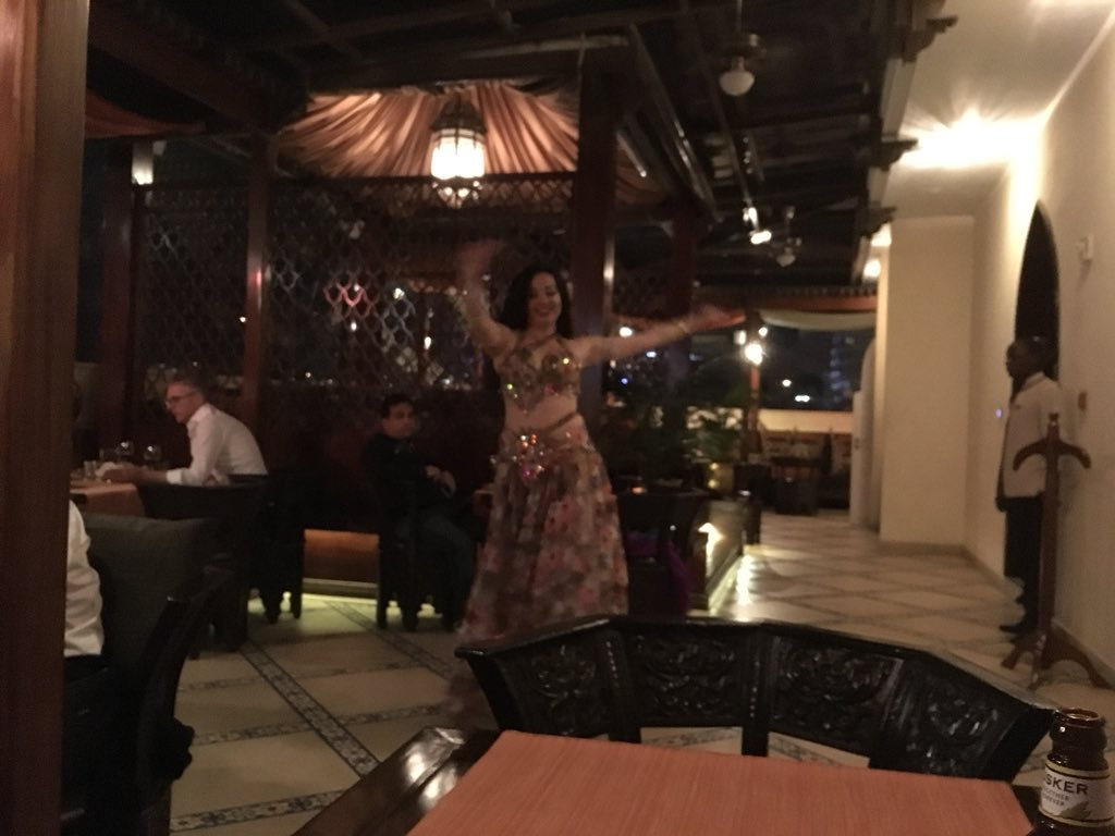 Very Frontier evening. Saw the body of a man who mistimed his run across the Mombasa-Nairobi road (7th fatality that the taxi driver's seen this year), two power cuts, and a belly dancer from the Urals in a Lebanese restaurant in Kenya