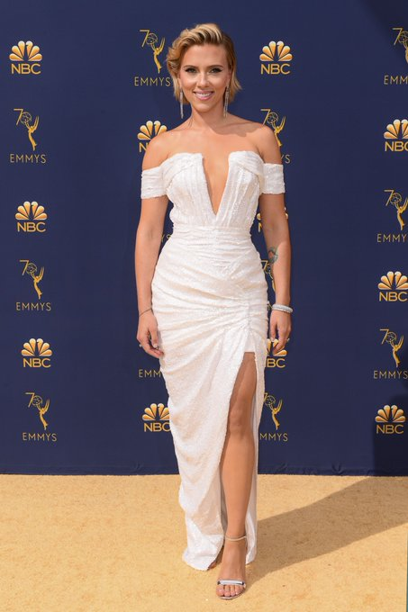 Black Widow looks gorgeous in white, too. Scarlett Johansson on the red carpet with #Emmys co-host @ColinJost Photo