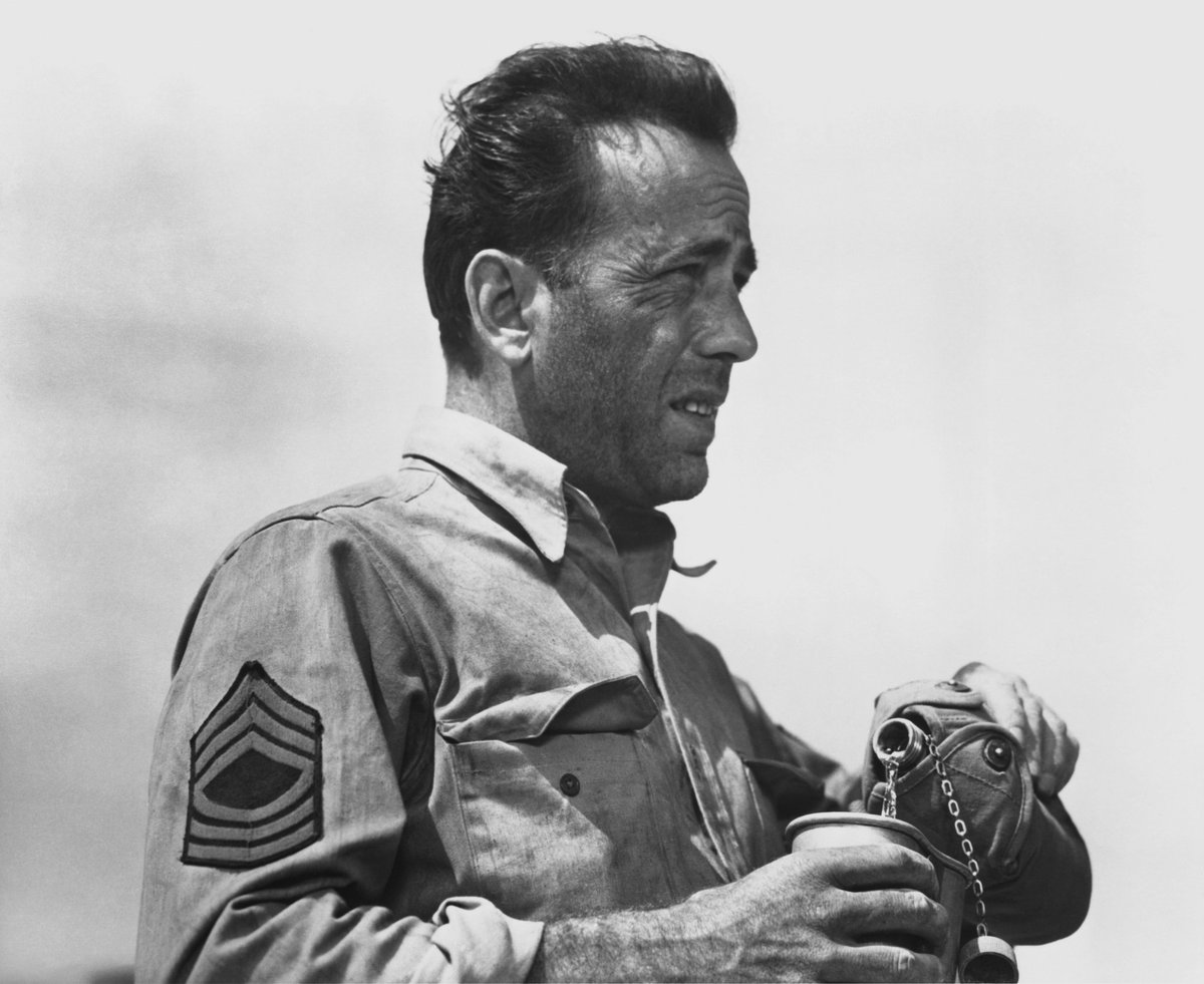 Humphrey Bogart as @USArmy Master Sergeant Joe Gunn in the 1943 film Sahara. Bogie portrays an American tank commander in Libya during WWII. By the way, the odds are close to zero that thats water in his canteen, right?