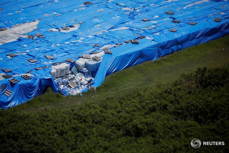 Pallets of unused water bottles are seen along an airplane runway a year after Hurricane Maria devastated Puerto Rico in Ceiba, Puerto Rico, by @Reuters photographer @ReutersBarria  See Reuters top photos from the last 24 hours: http://reut.rs/2plApod